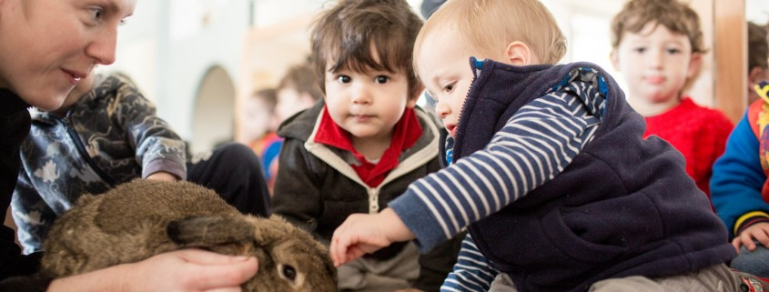 Carer and children with rabbit