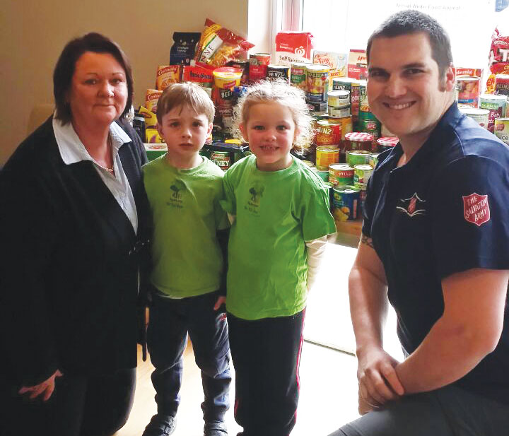 Centre Director Kym, children and Captain Nathan Hodges from The Salvation Army